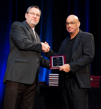 Eric B. Stewart, M.D. (right) accepts an award from the Health Resources and Services Administration.