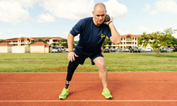 Image: Brett competes in shot put at the Wounded Warrior Pacific Invitational in Hawaii. / Photo Courtesy of the Department of Defense
