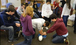 Image: Students at Episcopal School of Jacksonville practice hands-only CPR.