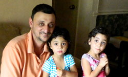 Image: Rahim Mohamad, shown here with two of his daughters, used to be unable to lift his children because of his pain.