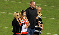 Image: Mark kept his promise to his daughter Masey to walk her across the football field during her high school
