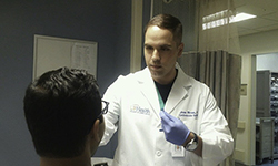 Image: Jose Rivas, MD, a postdoctoral research associate at the University of Florida College of Medicine – Jacksonville, performs a genetic swab on a cardiovascular patient.