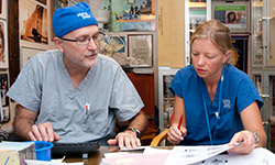 Image: Estelle worked alongside renowned oral and maxillofacial surgeon Gary Parker, DDS, during her time with Mercy Ships, which provides medical aid to developing countries via a traveling hospital ship. Estelle's time with Mercy Ships was part of the inspiration behind starting her own charity.