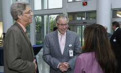 """Image: George """"Skip"""" Wilson III, MD, laughs with colleagues during a special drop-in reception to celebrate his 30 years of service on the UF Health Jacksonville campus. His last day was June 30."""