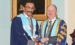 Image: Michael Lavelle-Jones, right, president of the Royal College of Surgeons of Edinburgh, congratulates Rui Fernandes, MD, DMD, on his induction into the organization as an ad hominem fellow.