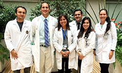 Image: UF COMJ pediatric resident Michael Haynes, DO (second from left), gathers for a photo with other residents and fellows who trained at Fundacion Cardioinfantil in Bogotá, Colombia. They are shown with attending physician Martha Alvarez, MD (pictured third from left), who helped establish the training partnership.