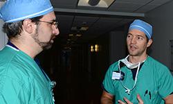 Image: Schwan, right, consults with Jason Widrich, MD, an assistant professor of anesthesiology at UF COMJ.