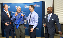 Image: UF Health leaders celebrate during a ceremonial ribbon-cutting to mark the opening of the Jacksonville Aging Studies Center. Pictured, from left, are UF Health President David S. Guzick, MD, PhD; Marco Pahor, MD, director of the UF Institute on Aging; Steve Anton, PhD, chief of clinical research in the department of aging and geriatric research; and Leon L. Haley Jr., MD, MHSA, dean of UF COMJ and CEO of UF Health Jacksonville.