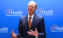 Image: David S. Guzick, MD, PhD, senior vice president for health affairs at the University of Florida and president of UF Health, addresses the gathering at the Friday, May 11, JAX-ASCENT ribbon-cutting ceremony.