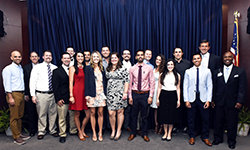 Image: Emergency medicine resident physicians, along with program and UF COMJ leaders, gather for a photo during Celebration of Education.