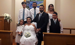 Gina Francica and her wedding party gathered in the chapel post-ceremony.
