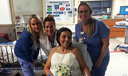 Gina Francica surrounded by some of the UF Health nurses responsible for her care and her wedding planning.