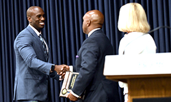 Image: Internal medicine resident Kevin Green, MD, receives the Ann Harwood-Nuss Resident Advocate Award from Leon L. Haley Jr., MD, MHSA, dean of the UF College of Medicine – Jacksonville.