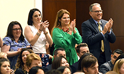 Image: Obstetrics and gynecology faculty members applaud during Celebration of Education.