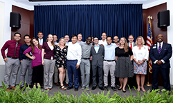 Image: Graduating emergency medicine residents gather for a group photo during the ceremony.