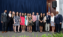 Image: Graduating pediatric residents gather for a group photo during the ceremony.