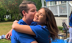 Image: Wells embraces his fiancée while celebrating his Match Day results. The small, private function was planned after the traditional in-person event at UF was cancelled because of COVID-19.