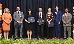 Image: Issa Hanna, MD; Maedeh Ganji, MD, MBA; Alexander Ghannam, MD; and Sandra Siller, MD, who gave platform presentations on their respective research projects, are flanked by college senior leaders while being recognized for their discoveries.