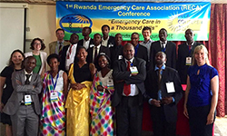 Image: In this photo from 2016, DeVos, on the far left in black, gathers with a group of Rwandan emergency medicine resident physicians during the first Rwanda Emergency Care Association Conference.