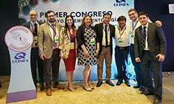 Image: In this photo from 2919, DeVos, pictured fourth from left, gathers with other attendees of the first Paraguayan Society of Emergency Medicine Conference in Asunción.