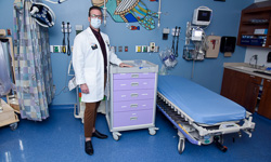 Image: Doug Suffield, a pain education specialist, pictured in the UF Health Jacksonville emergency department.