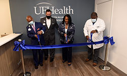 Image: From left to right: UF Health Jacksonville CEO Dr. Leon L. Haley, Jr., Florida senator Aaron Bean, vice president of community engagement and chief diversity officer Ann-Marie Knight, and medical director of the UF Health Total Care Clinic – Jacksonville Dr. Ross Jones cut the ribbon on the Social Services Hub.