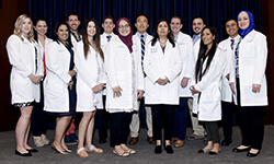Image: Graduates of the pediatric residency program gather for a group photo during Celebration of Resident and Fellow Education and Research Day.