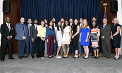 Image: Graduates of the internal medicine residency program gather for a group photo during Celebration of Resident and Fellow Education and Research Day.